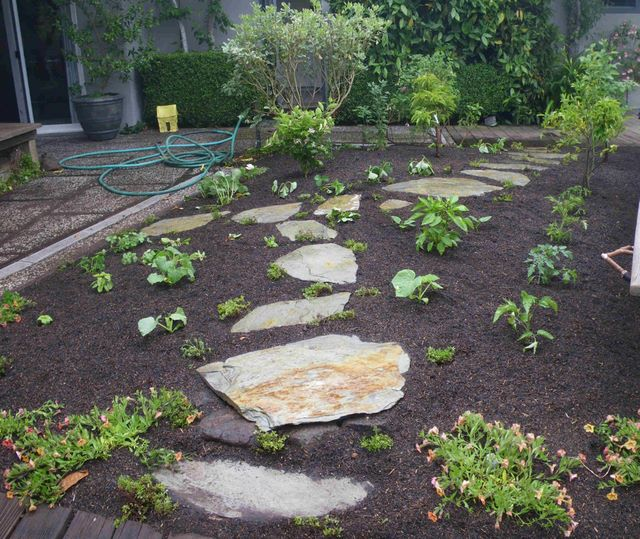 Stepping Stone For Garden Stepping stones in flower bed laidback gardener 20150307 workwithnaturefo