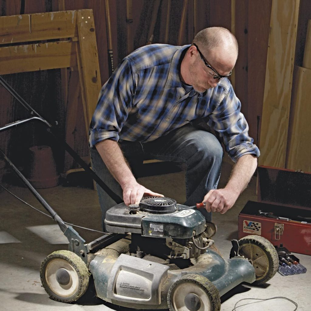 Man fixing lawnmower