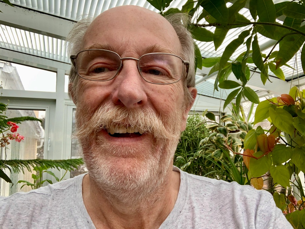 Selfie of Larry Hodgson in his greenhouse