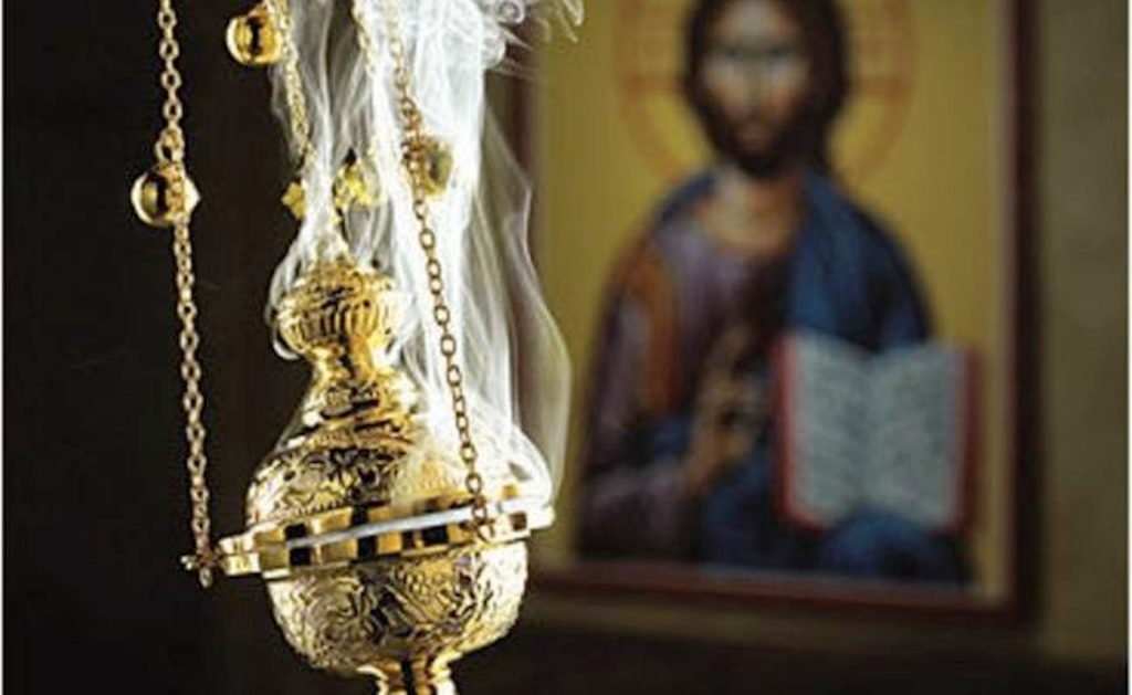 Incense being burned in a thurible.