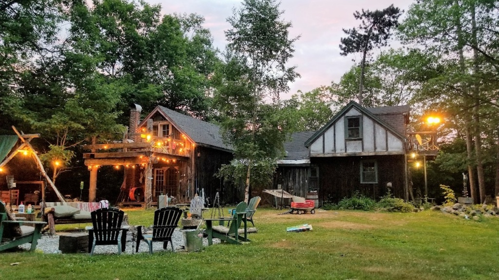 Large backyard with ampler rest area and Adirondack chairs.