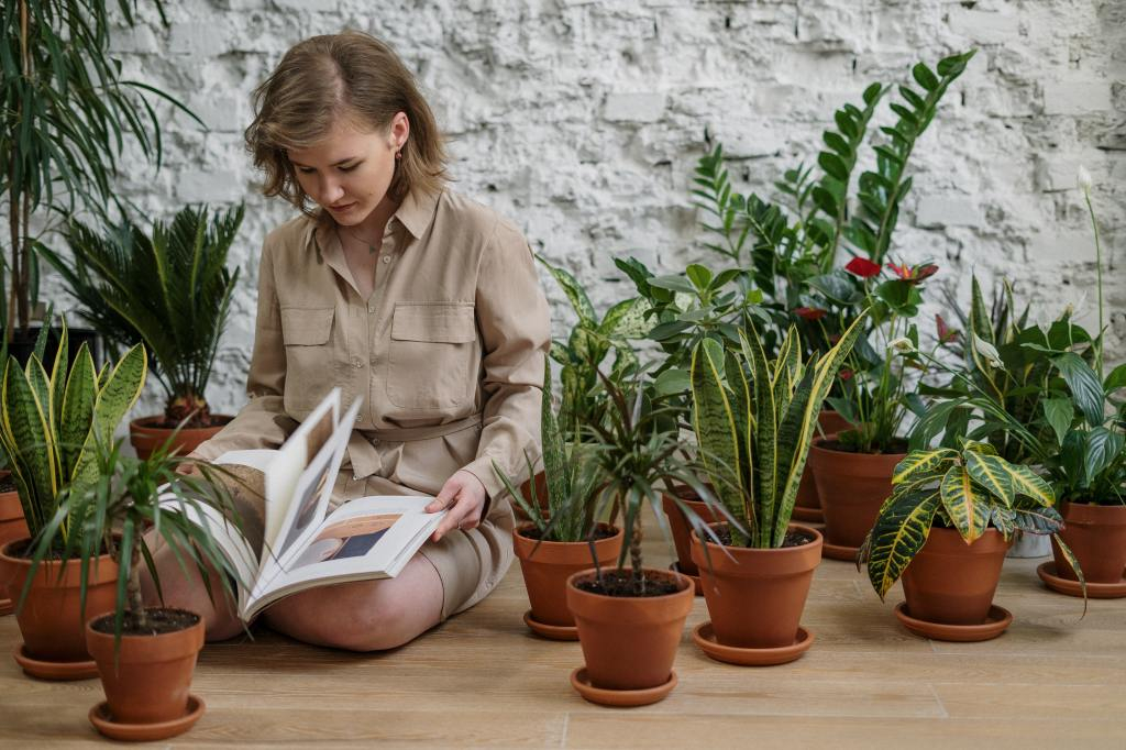 Woman consulting book while surrounded by houseplants.