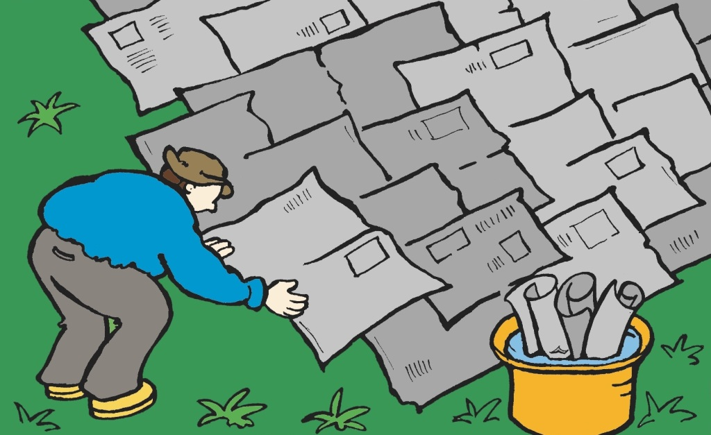 Illustration showing the installation of a newspaper barrier on a lawn.