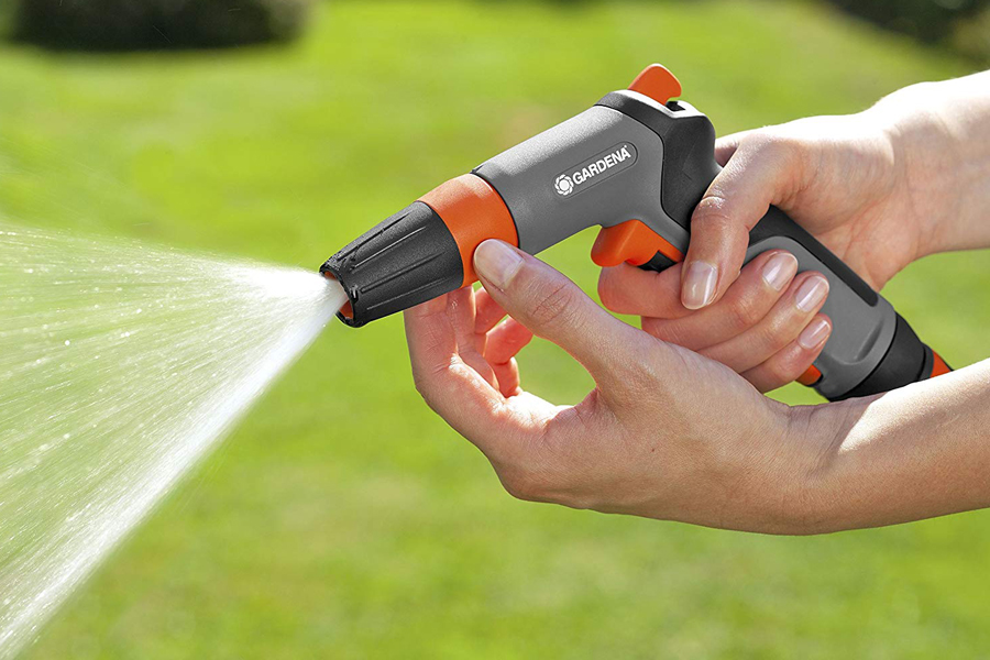 Spray nozzle being adjusted by hand.