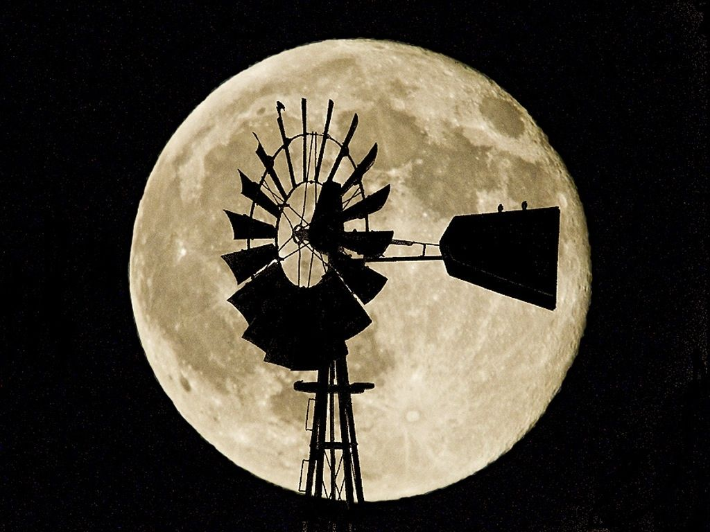 Windmill in front of full moon.