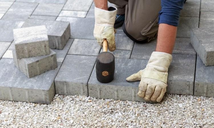 Installing paving stones.