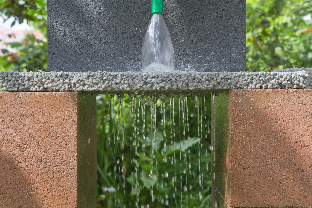 Permeable paver with water flowing through it.